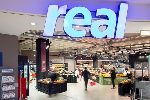 © real GmbH